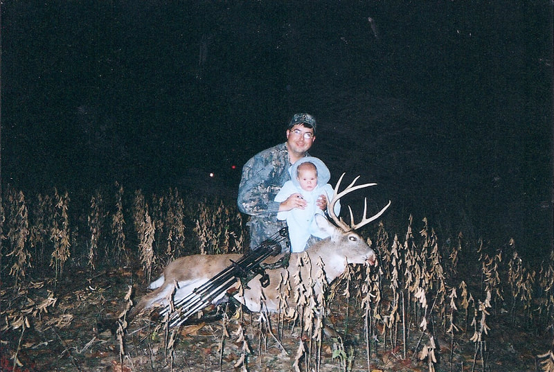 Father and Son with Trophy Buck